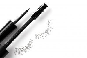 Black mascara on white background.