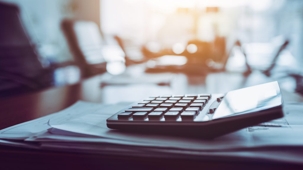 Close up of a calculator on the desk of an economic damages expert.